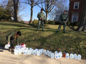 A woman distributes drinking water on the Governor's lawn for the residents of impacted by the Freedom Industries chemical spill. Photo Credit: Creative Commons/ Mountain Justice